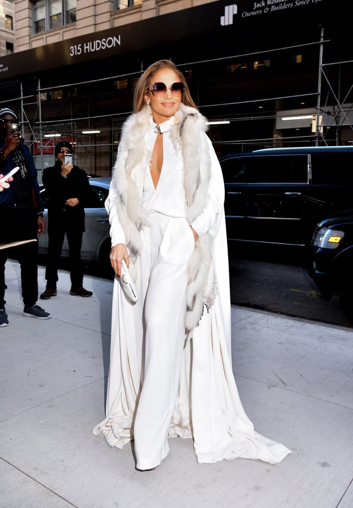 "Jennifer Lopez's closet is just the gift that keeps on giving. Just when we think we've gotten our share of holiday outfit inspiration from the 49-year-old singer, she debuts another glamorous look that leaves our jaws on the floor. Case in point: J Lo's dramatic all-white ensemble from her Watch What Happens Live appearance on Dec. 11. Such a throwback to her '90s ""Jenny From the Block"" days!  She opted for a long white coat with a furry collar, and chose a stunningly sexy Chanel jumpsuit with a plunging neckline to wear underneath. J Lo tied the whole look together with a matching clutch, For Art's Sake geometric sunglasses, and a pair of metallic Jimmy Choo heels. Check out more snaps of her outfit ahead. If you completely lose your chill over this look, we understand.      Related:                                                                                                           Take a Seat, Because Jennifer Lopez's Sexy Dresses Need Your Undivided Attention"