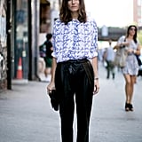 We'd love her floral top and leather pants on their own, but together, they were a standout outfit.