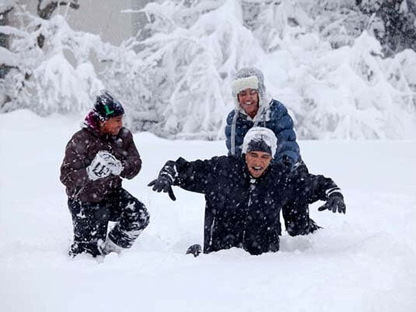 President Barack Obama was in deep snow when he played with his daughters, Sasha and Malia, in Washington DC in January 2011.  Source: Facebook user Barack Obama