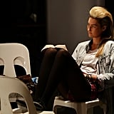 This model found a spot to read during Rosemount Australian Fashion Week in 2010.