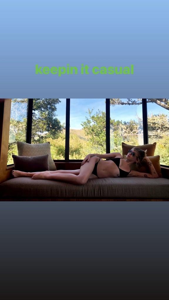 Miley Cyrus Wearing a Black Bikini