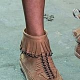 Wang brought back the fringed moccasin.