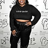 Of course, Lizzo looks amazing in her own merch. She pair cropped Lizzo 20/20 hoodie with classic Dr. Marten's combat boots and a pair of shimmery black sweats.