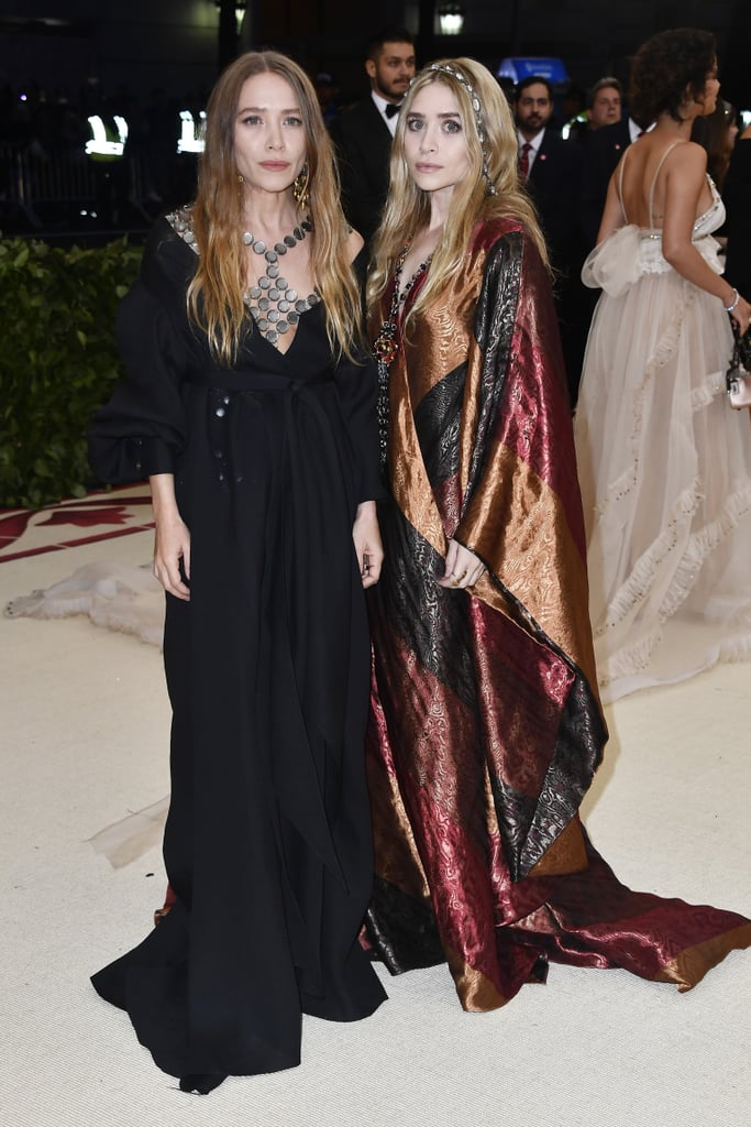 Mary-Kate and Ashley Olsen are Met Gala staples, wearing some of the most memorable gowns of the night through the years — and, in 2018, they didn't disappoint. The designers, creators of The Row and Elizabeth and James, came to conquer the red carpet at the Metropolitan Museum of Art's Costume Institute gala in their own designs. As they stepped out for the biggest night in fashion on Monday, May 7, the Olsen sisters made a somewhat subtle nod to the night's theme of Heavenly Bodies: Fashion and the Catholic Imagination with their colour choices and statement jewellery. Mary-Kate and Ashley wore pieces from The Row — they also dressed Lady Bird director Greta Gerwig — and we're still in awe over their boho looks. Mary-Kate chose a simple long black gown, keeping all eyes on the big statement piece she wore around her neck, a large necklace resembling a piece of armour a la Joan of Arc. Ashley, on the other hand, opted for colour and lots of it, wearing a patch-work silk gown with an equally stunning rosary necklace, tying back to the religious theme. Her look was topped off with a jewelled headband that we definitely wish we could get our hands on ASAP.       Related:                                                                                                           90 Styling Hacks We Learned From Mary-Kate and Ashley Olsen