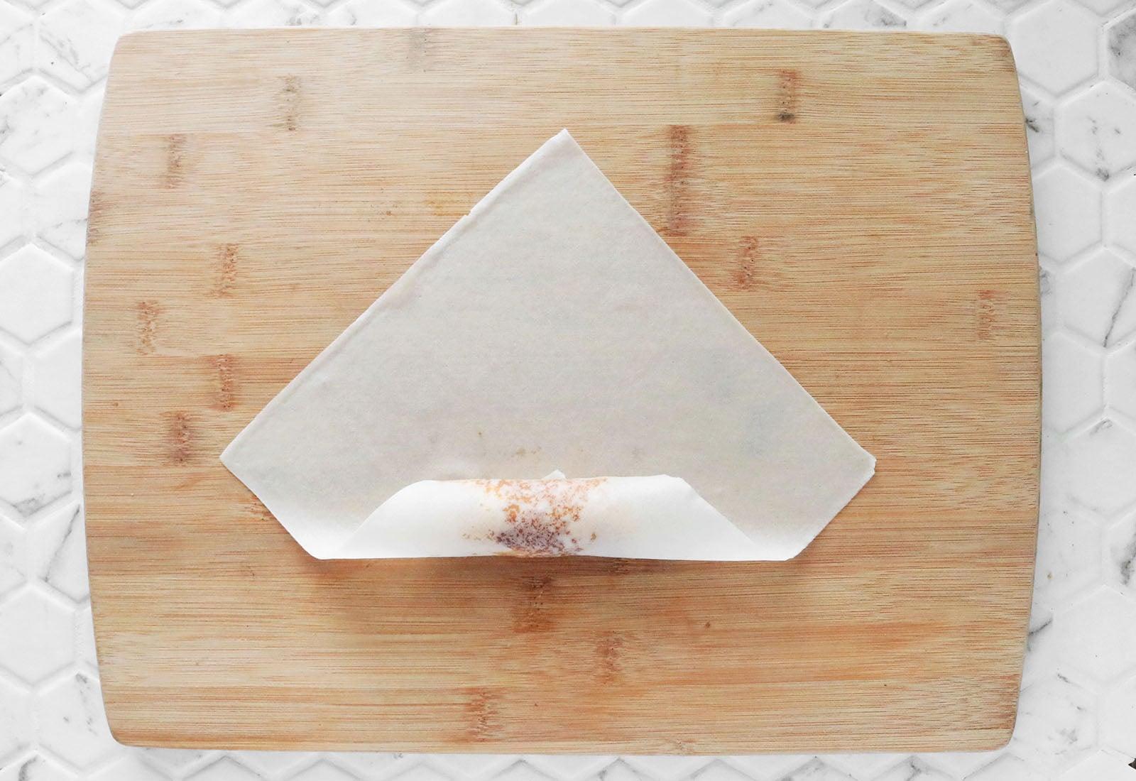 Fold up bottom corner of wrapper
