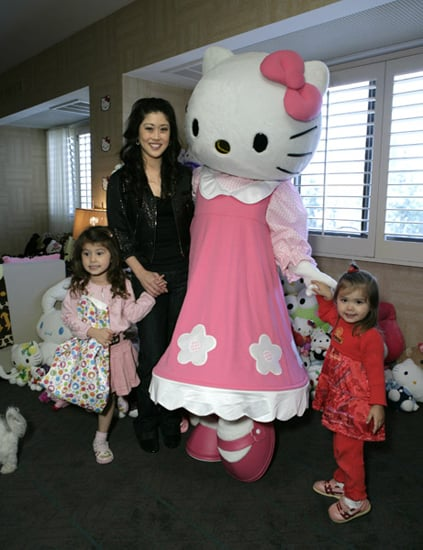 <b>Dancing With the Stars</a> Olympic ice skater Kristi Yamaguchi and her girls loved up on the big cat, too.