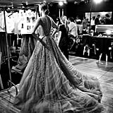 A model prepares to walk at the Elie Saab show.