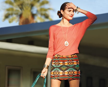 Stand out this spring with a bold printed skirt. It's perfect for punching up your look. Just add a colorful shirt, a pendant necklace, and you're good to go!