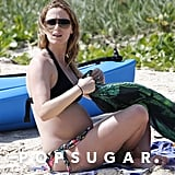 Emily Blunt's baby bump was on display during a beach day in Oahu, HI, with John Krasinski and Bradley Cooper.