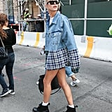 Hailey Baldwin let a pair of white socks stick out of her own combats, styling the combination with a flannel and denim mixed-material jacket.