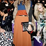 At Noon by Noor in NYC, Olivia topped her orange maxi with a sparkly colorblocked sweater and plush fur vest.