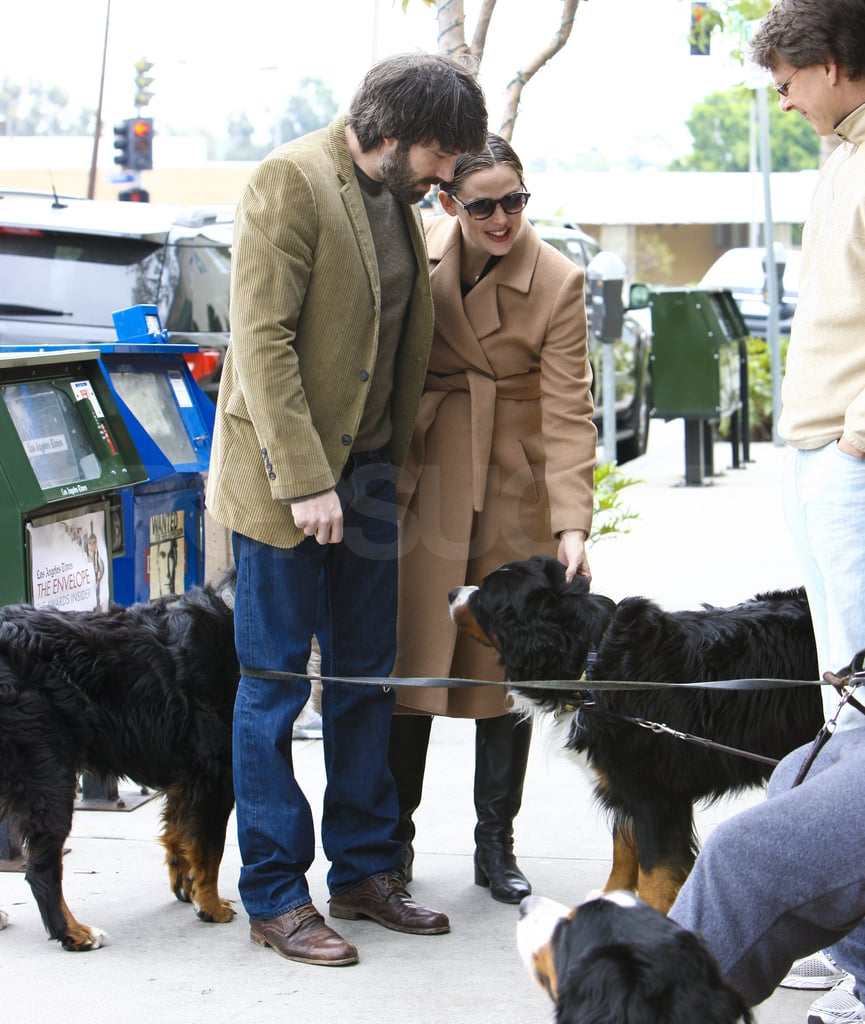 Ben and Jen stopped to pet a dog.
