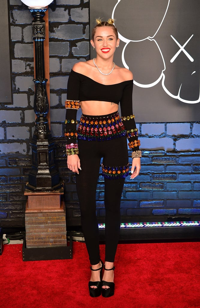 Cyrus hit the 2013 MTV Video Music Awards red carpet an ab-flaunting Dolce & Gabbana duo. Her matching top and leggings were both adorned with brightly colored rhinestones, not to be outshined by over 100 carats of Lorraine Schwartz diamonds (a necklace, earrings, and rings).