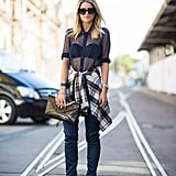 We can't get over this cool-girl combo that made use of a sheer blouse, punky plaid, and sexier heels. Source: Le 21ème   Adam Katz Sinding