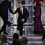 Seth Meyers bowed to Andy Samberg while presenting his Golden Globe.