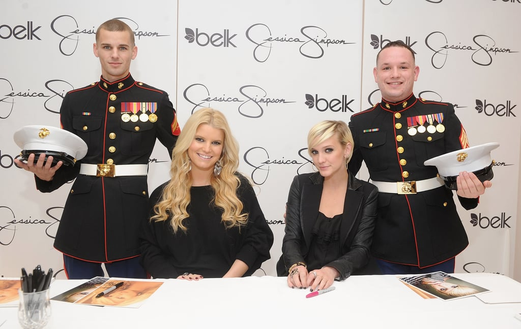 Jessica Simpson and Ashlee Simpson with two military fans.