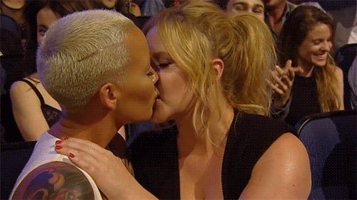 Amber Rose and Amy Schumer Kiss at 2015 MTV Movie Awards