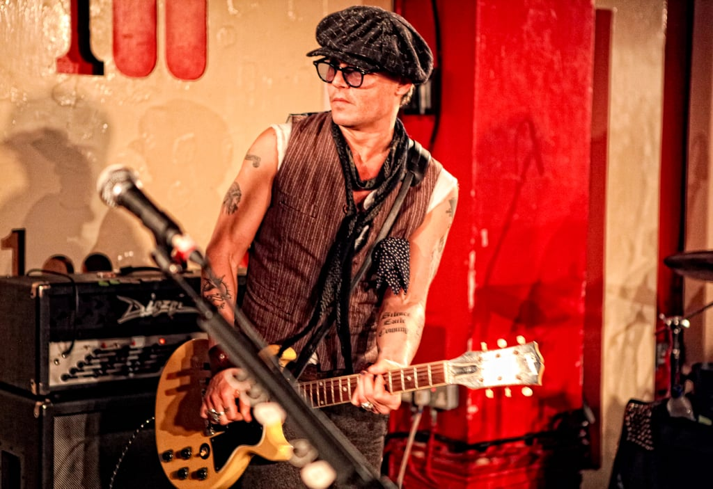 """Johnny Depp took the stage with Alice Cooper to perform a surprise gig at The 100 Club in London last night. Johnny joined the legendary musician to take on """"I'm Eighteen"""" and """"School's Out"""" in support of Cooper's new album Welcome 2 My Nightmare. Alice Cooper reportedly introduced the A-list star on stage as """"the blues master, Mr Johnny D from Kentucky,"""" and later joked that the actor could have a permanent place in the band. Johnny Depp, who scored number two in your 10 sexiest celebrity men 100 list and the very top spot in the 2011 PopSugar 100, showed off his toned and tattooed arms as he rocked out with Alice. Johnny is currently in London shooting his latest Tim Burton film, Dark Shadows, and Alice Cooper is rumored to be returning the favor and making a cameo in the movie."""