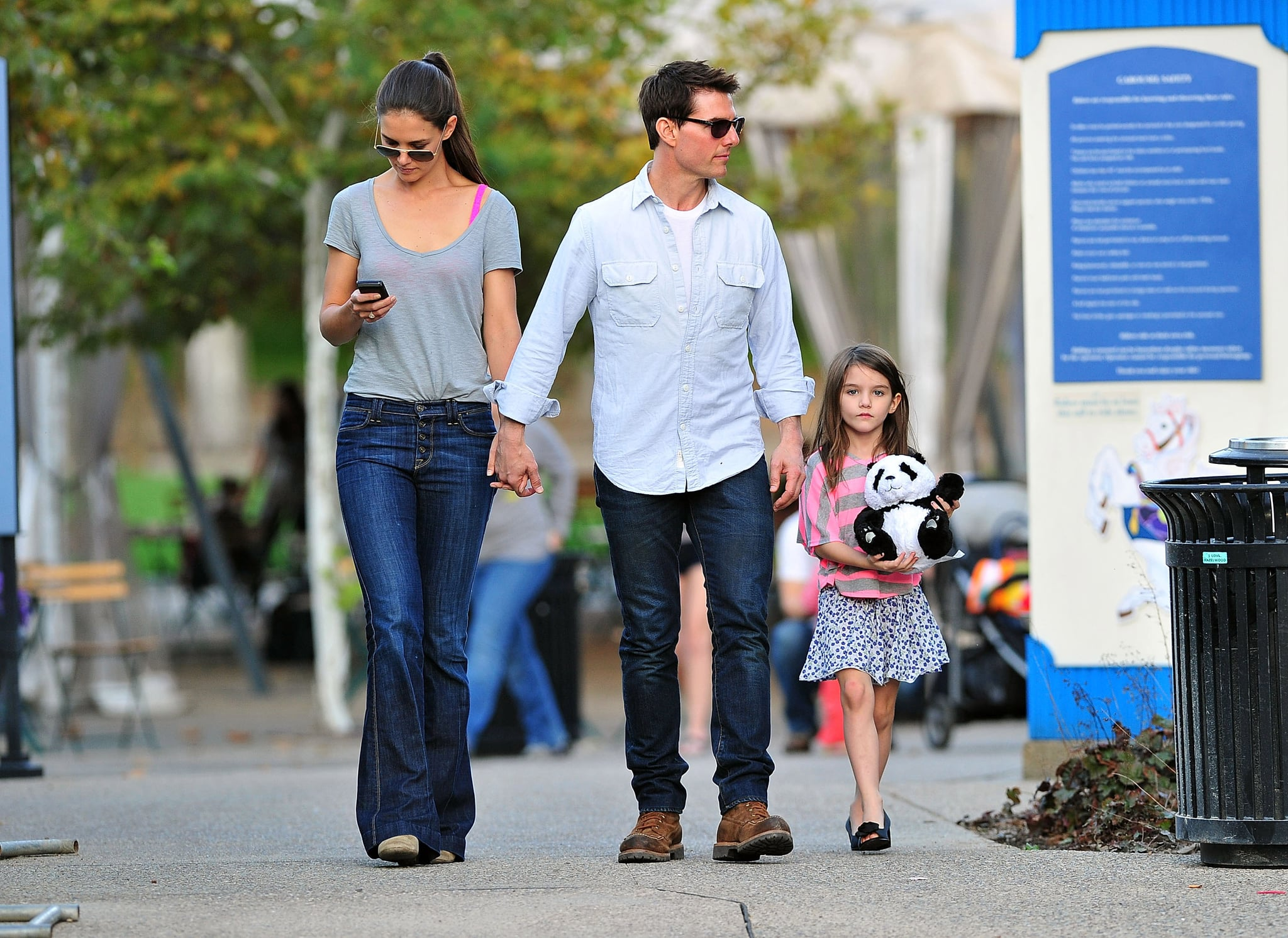 Tom Cruise and Katie Holmes walked around Pittsburg with Suri Cruise.     Suri Cruise Pushes Her Stroller Out With Tom and Katie in PA    POPSUGAR Celebrity Photo 6