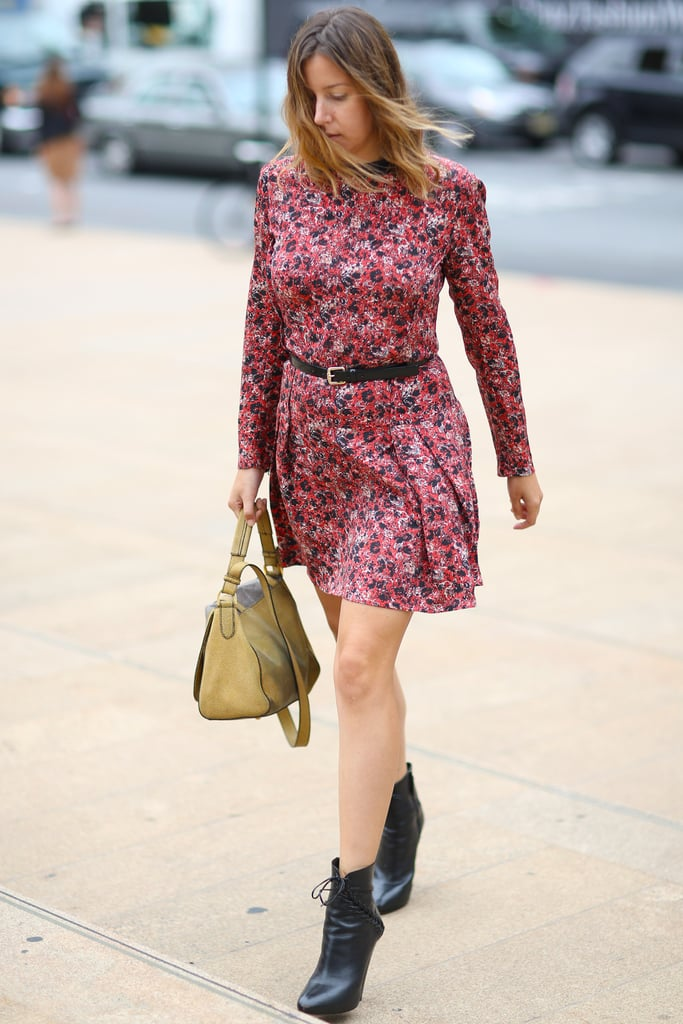 This styler took her printed minidress right into Fall with a pair of lace-up ankle boots. Source: Greg Kessler