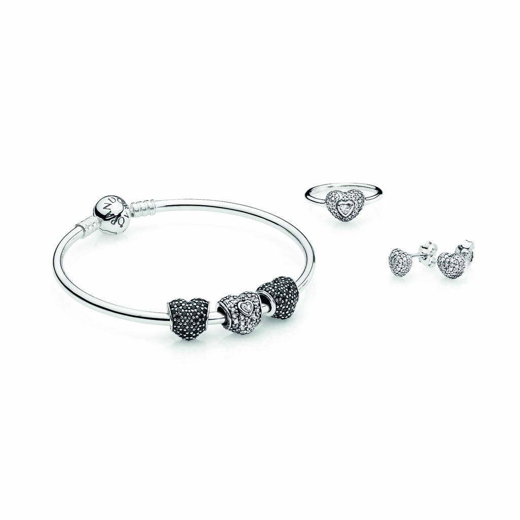 Silver bangle bracelet,$69, silver pavé heart charm, $79, black pavé heart charms, $69 each. Silver ring with pavé cubic zirconia, $79, and silver earring studs with pavé cubic zirconia, $69.