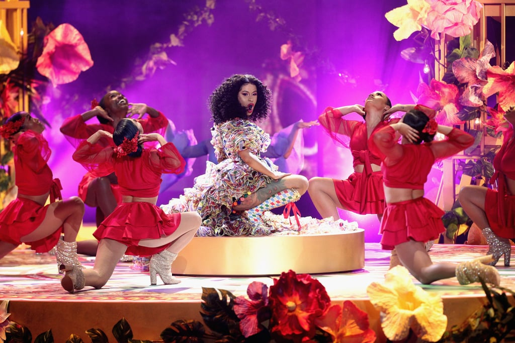 "You would never know that Cardi B had a baby a few months ago! The new mother lit up the American Music Awards stage on Tuesday night, performing her hit single ""I Like It"" with Bad Bunny and J Balvin. Much like the vibrant music video, the performance gave us serious Summer vibes, from the colorful palm trees on stage to the dancers riding bikes and dressed in every shade under the rainbow. This is definitely another Cardi performance for the books. Check out the video ahead!      Related:                                                                                                           Taran Killam's Reaction to Cardi B's AMAs Performance Is the Definition of Priceless"