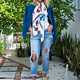 With Distressed Jeans, a Colorful Handkerchief, a Blue Jacket, and Creepers