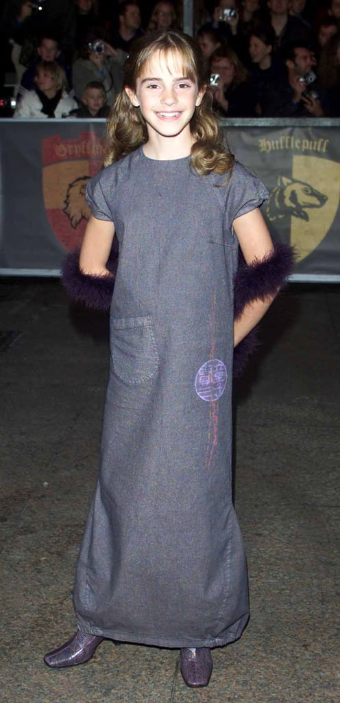 Then: Little Miss Hermione Granger! At the Harry Potter premiere, Emma went for shades of purple and grey. We just can't get over that furry stole!