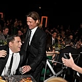 Brad Pitt and Angelina Jolie sat at a table with Jonah Hill.