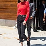 Welcome Fall in a bold red sweater like Gigi's. The model also matched her top to her sunglasses.