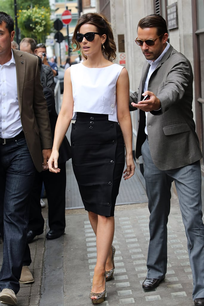 On another occasion, Kate donned a black-and-white outfit: white crop top, black high-waisted pencil skirt, spiked Christian Louboutin peep toes, cat-eye sunglasses, and these gold spiked Melinda Maria earrings ($80).