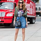 """A styling hack: tuck your bomber into your skirt for that """"falling off the shoulder"""" jacket look."""