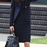 Kate Middleton in a blue sheath dress and blazer leaving the UK for Canada in June 2011.