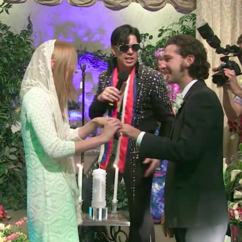 "Shia LaBeouf and Mia Goth surprised fans when they said ""I do"" in October 2016 alongside Elvis, a fog machine, and a hula dancer at a Las Vegas chapel. The couple tied the knot at Viva Las Vegas and live-streamed the entire ceremony on TMZ."
