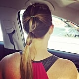 For a variation, start with a half-up, half-down ponytail style and then gather more and more hair with each band as you work your way down.