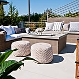 Lauren considers the outdoor fire pit an extension of the home, and she strives to make it as cozy as the indoor spaces by filling it with plush pillows, like these from HomeGoods.