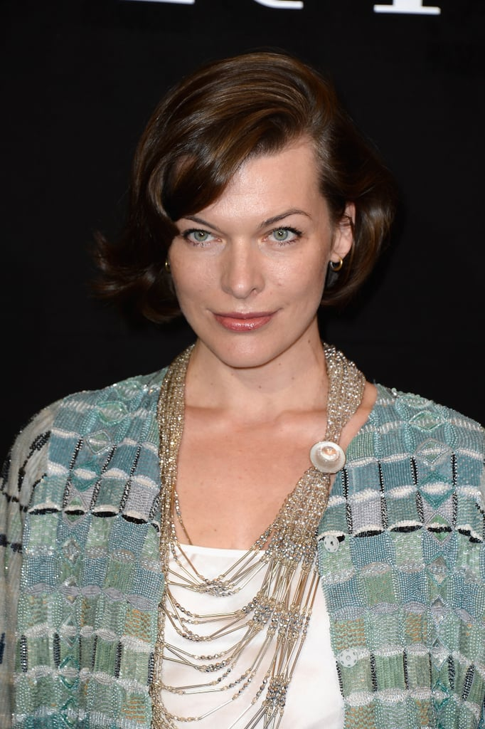 At Giorgio Armani Privé, Milla Jovovich stuck with her signature hairstyle and wore a simple makeup palette: a touch of mascara and a dab of pink gloss.