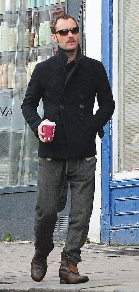 Jude Law strolled in London with a coffee in hand yesterday. He's still sporting his Sherlock Holmes 2 moustache, after letting the rest of his facial hair grow during his New Year's break with Sienna Miller in Nairobi. Jude spent the Autumn filming the sequel with Robert Downey Jr and Stephen Fry. Robert and Jude have given a behind-the-scenes tour and chatted about dressing up as women ahead of the movie's release on Dec. 16. Jude's now preparing for his return to the London stage this Summer. He's teaming up with Michael Grandage again following his success as Hamlet, and their new project is Eugene O'Neill play Anna Christie. Jude will also narrate a short film for which Damon Albarn has composed the score.