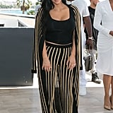 "Kim styled her Fall 2015 Balmain set with her dainty ""Nori"" necklace, her engagement ring, and simple black sandals."