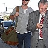 Liam Hemsworth stepped out at the airport in LA.