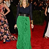 Ivanka Trump donned a green pleated skirt with gold spiked jewels from her own line, a Nancy Gonzalez clutch, and added streaks in her hair for that extra punk touch.