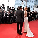 Uma Thurman and Quentin Tarantino had a laugh at the closing ceremony and premiere of A Fistful of Dollars.