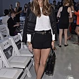 Olivia Palermo gave an update to the little black jacket when she paired her ladylike staple with a white top, black shorts, and playful flats at Rebecca Taylor.