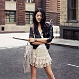 Liu Wen is one of the models and sources of inspiration for H&M newest collection called The New Icons. We love how she mixed and matched tougher pieces (a moto leather jacket) with bohemian elements (a ruffled skirt and a fringed satchel). If you're not big on ruffles, you could pair a similarly tough jacket with an airy floral-print skirt to create the same opposites-attract effect.