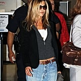 In 2009, Jen made these bug eye lenses appropriate for traveling, rocking them with baggy boyfriend jeans at the airport.