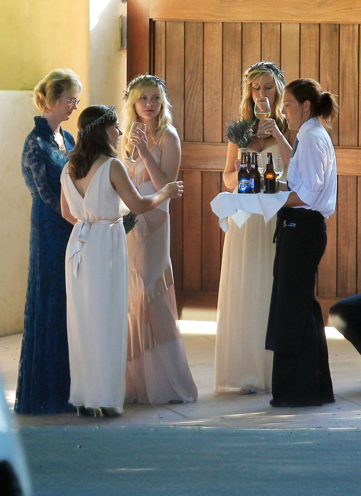 Kirsten Dunst chatted with fellow wedding guests.