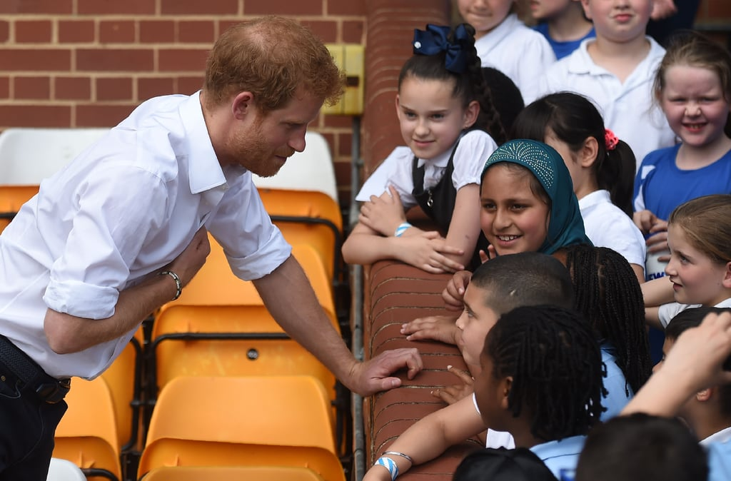 """Prince Harry officially kicked off his two-day visit to Leeds on Thursday. The royal attended the Leeds Leads: Encouraging Happy Young Minds charity fair, where he took part in a panel and addressed the mental well-being of the city's young people. Harry praised the community for their commitment to encouraging people to seek help for mental health problems, saying, """"I have been so impressed by the commitment of this City and the Leeds Community Foundation in focusing on mental health. You have been leading the way in bringing funding and expertise together in support of local community solutions."""" Harry then spent his afternoon at the Sky Try Rugby League Festival, which aims to inspire students across Leeds to take up the sport. Not only did Harry turn on the charm while coaching a group of kids and chatting it up with the team's mascot, but he also fully embraced his new role as patron of the Rugby Football League.       Related:                                                                                                           38 Times Prince Harry Was Out-of-Control Cute With Kids               Harry has been opening up more and more in recent months about his own mental health battles. In addition to launching the mental health campaign Heads Together with Prince William and Kate Middleton, the royal recently talked about how he sought professional help to cope with the tragic death of his mother, Princess Diana. """"Not to get too personal, if you lose your mum at the age of 12 then you've got to deal with it and the idea that . . . 15, 17 years later I still hadn't dealt with it, Afghan was the moment,"""" he said in an interview with Forces TV. """"Once I plucked my head out of the sand, post-Afghan . . . it had a huge . . . life-changing moment for me. It was like, right, you are . . . Prince Harry, you can do this, as long are you're not a complete tit, then you're gonna be able to get that support, because you've got the credibility of 10 years' service and"""