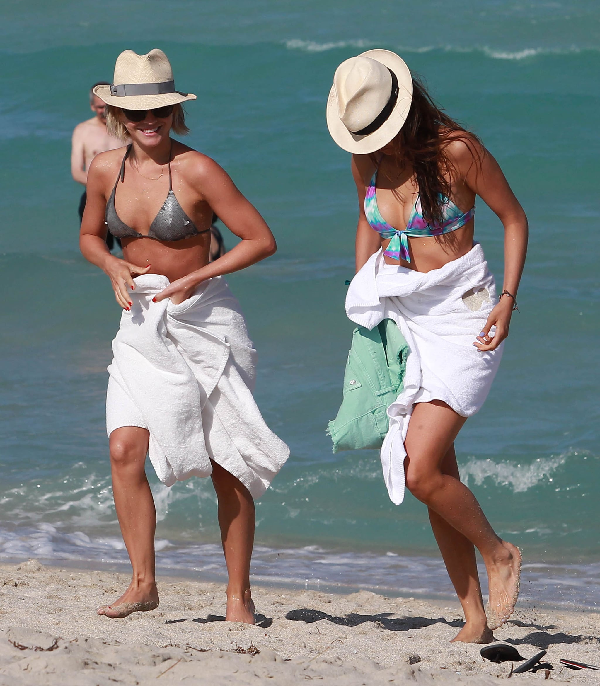 Julianne Hough and Nina Dobrev walked in the sand on the beach in Miami.