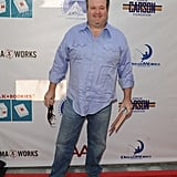 Eric Stonestreet was all smiles as he posed for photos at the Milk and Bookies event.