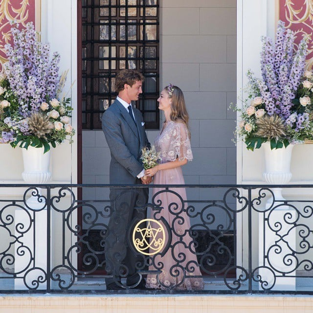 """Pierre Casiraghi and his girlfriend, Beatrice Borromeo, made it official on Saturday when they got married in a civil ceremony at Monaco's Pink Palace. Valentino, the design house behind the bride's pale pink Valentino Haute Couture dress, shared a picture of the affair on Sunday. The Instagram image shows the new spouses smiling and locking eyes on a balcony. After their ceremony, Beatrice changed into another gorgeous gown for their wedding reception at Monaco's Hotel de Paris, to which she arrived in a Rolls-Royce.  The couple, who have shared plenty of sweet moments in their six years together, later celebrated their nuptials with a garden party at the palace. The event, which Prince Albert called """"mostly informal,"""" was held outdoors and had a carnival theme. Their """"low-key"""" wedding will be followed by another, more lavish ceremony and reception on Beatrice's family's private island in Italy next weekend. The couple isn't the only royal duo to tie the knot this year — Prince Carl Philip and Princess Sofia of Sweden got married in June and showed plenty of PDA during their big day."""